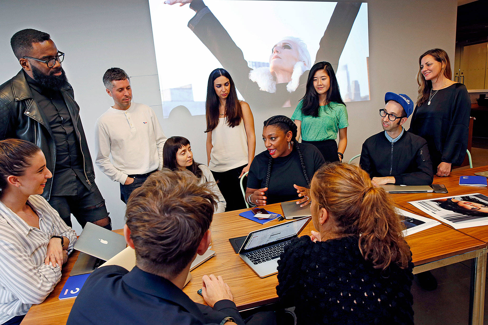 Members of the Droga5 team behind the recent CoverGirl campaign talk about that campaign during a meeting at the advertising agency's headquarters in New York on Tuesday. (AP Photo/Kathy Willens)