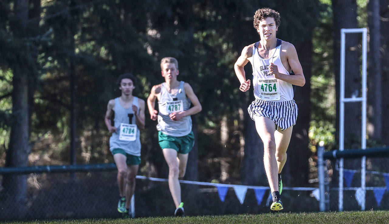 Glacier Peak's Riley McDowell (right) leads Jackson's Joseph Skoog (center) and Mateo Rivera during the 4A District 1 cross country championships on Oct. 28, 2017, at South Whidbey High School in Langley.