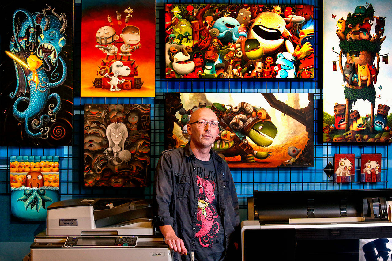 Artist Justin Hillgrove, creator of Imps and Monsters, in his studio. (Dan Bates / The Herald)
