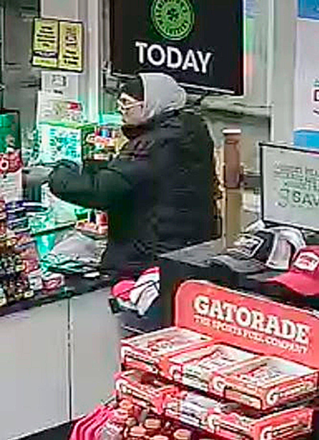 He wore glasses with translucent yellow stripes, a black beanie, light-colored gloves and a gray sweatshirt under a puffy black coat. (Courtesy of the Island County Sheriff's Office)