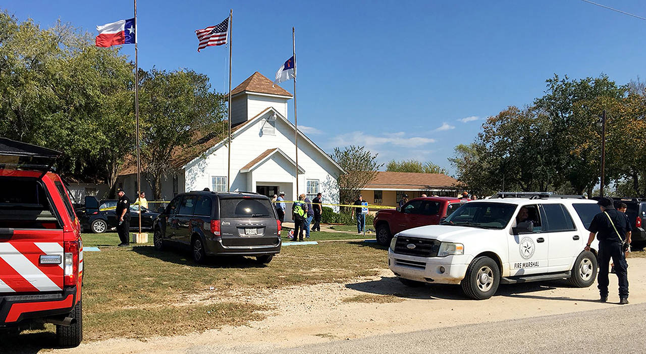 Emergency personnel respond to a fatal shooting at a Baptist church in Sutherland Springs, Texas, on Sunday. (KSAT via AP)