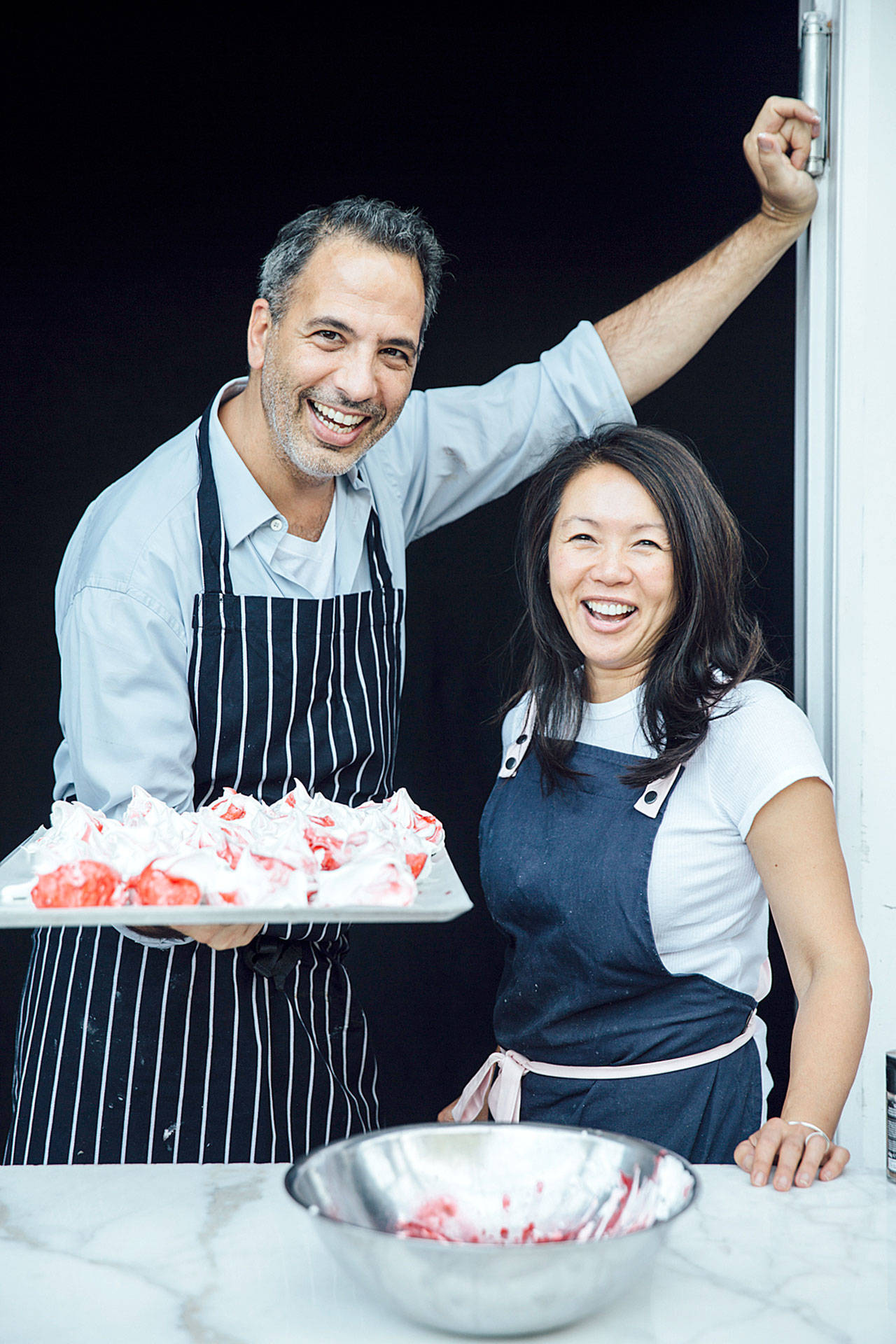 Yotam Ottolenghi and Helen Goh are the authors of this sweet cookbook. (Peden + Munk photo)