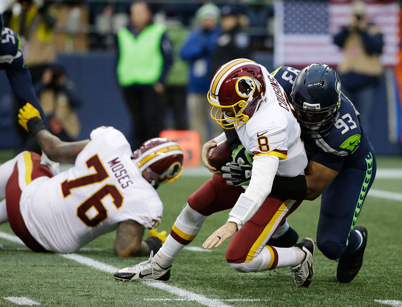 Seahawks defensive end Dwight Freeney (93) sacks Redskins quarterback Kirk Cousins (8) in the second half of a game Nov. 5, 2017, in Seattle. (AP Photo/Elaine Thompson)