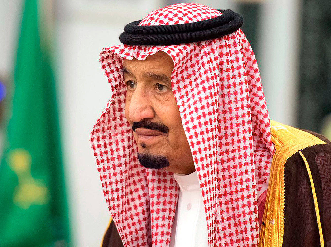 King Salman attends a swearing-in ceremony in Riyadh, Saudi Arabia, on Monday. The king has sworn in new officials to take over from a powerful prince and former minister believed to be detained in a large-scale sweep that has shocked the country and upended longstanding traditions within the ruling family. (Saudi Press Agency, via AP)