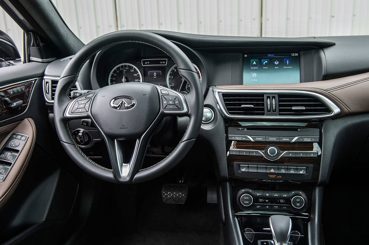 The Infiniti QX30's InTouch infotainment and connectivity system is easy to use, and climate system controls are well placed. (Manufacturer photo)