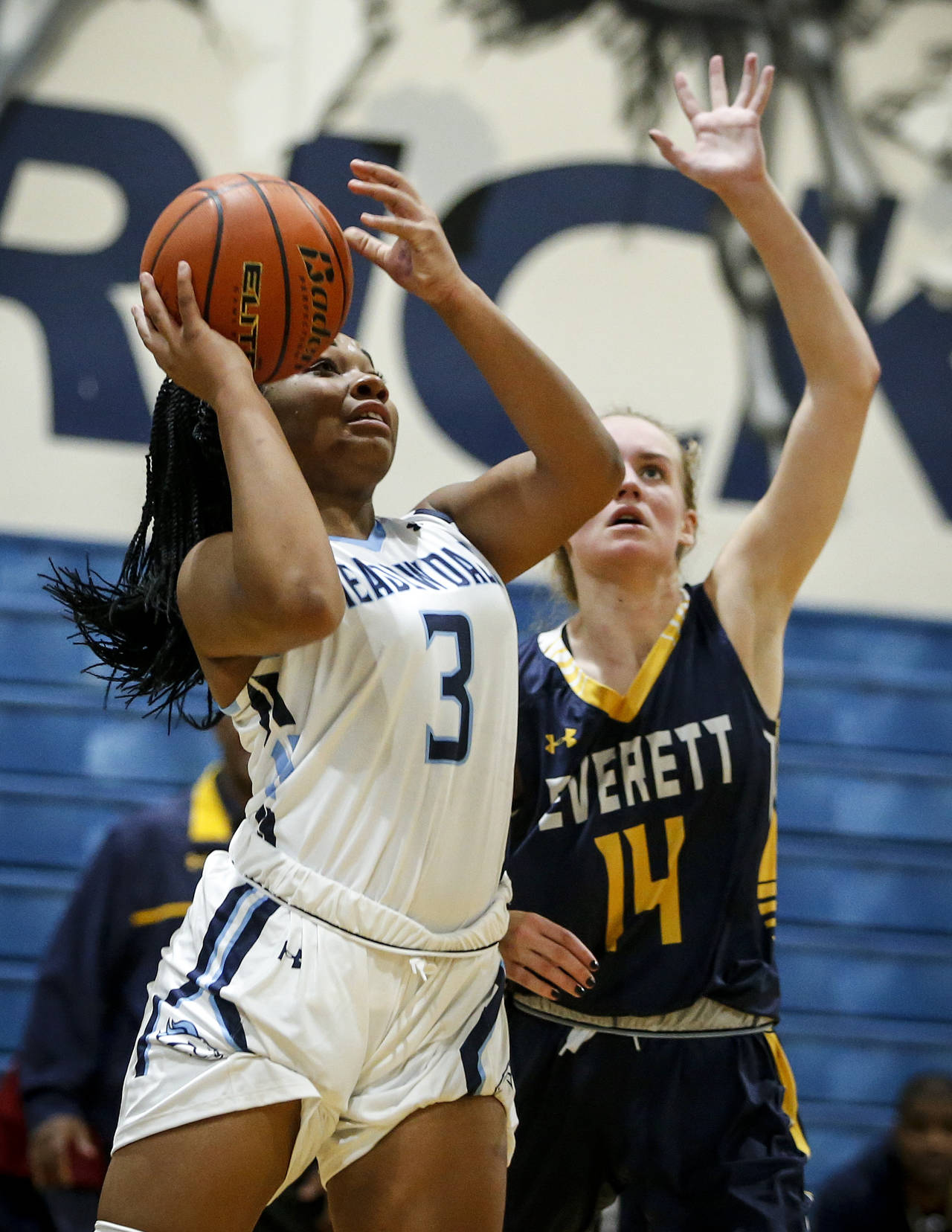 Meadowdale's Alicia Morrison (3) goes up for a shot as Everett's Kate Pohland (14) defends during a game Nov. 28, 2017, at Meadowdale High School in Lynnwood. (Ian Terry / The Herald)