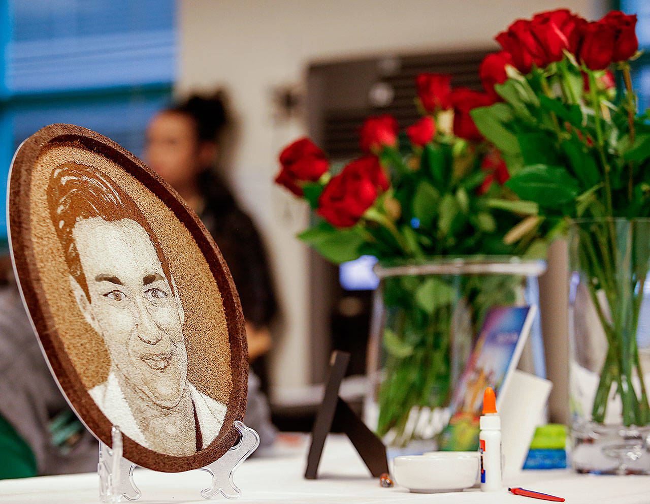 "The ""floragraph"" of Parker's image (left) is made of seeds and other natural materials. The eyebrows are left unfinished so his mom, Vicki Moore and others close to her can finish it before it goes to Pasadena, California, to adorn the Donate Life Rose Parade Float. (Dan Bates / The Herald)"