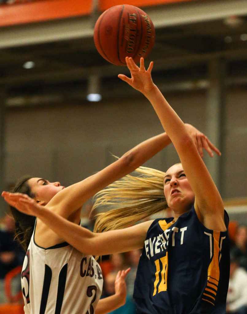 Everett's Morgan Carter (right) is fouled by Cascade's Brooke Alcayaga during the Seagulls' 50-23 win over Cascade on Friday night during Bru-Gull Fest at Everett Community College. (Kevin Clark / The Herald)