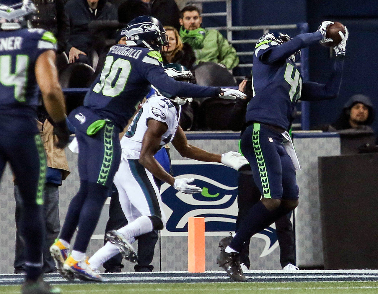 Seahawks Bryon Maxwell makes an interception to seal the win agains the Eagles Sunday night at CenturyLink Field in Seattle on December 3, 2017. Seattle won 24-10. (Kevin Clark / The Herald)