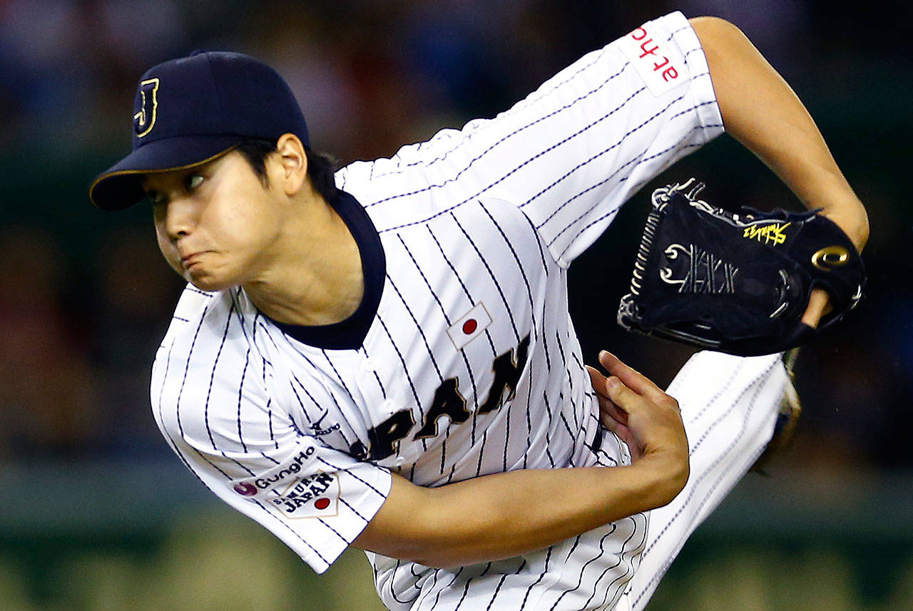 Japan's Shohei Otani pitches against South Korea during the first inning of a semifinal game of the 2015 Premier12 world baseball tournament in Tokyo.