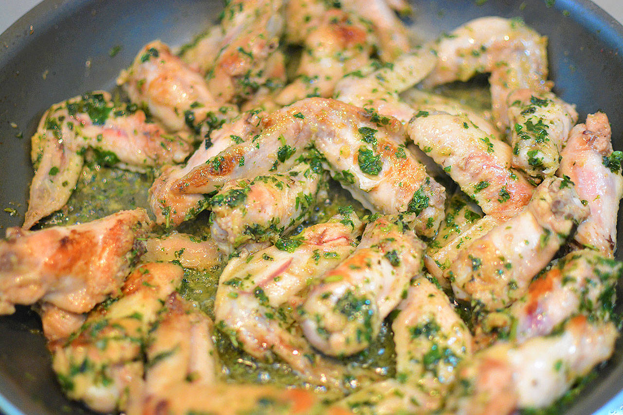 These chicken wings are bursting with flavors of mint, chilies, garlic and lime. (Reshma Seetharam)
