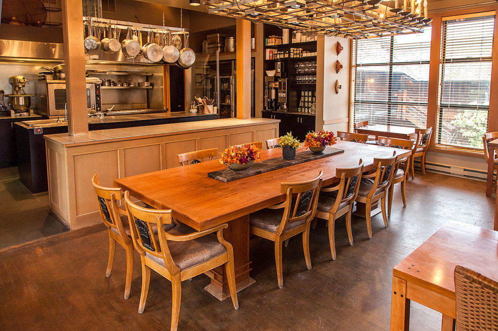 The open kitchen at the Inn at Langley features a rustic wood farm-style table. (Photo courtesy of the Inn at Langley) The open kitchen at the Inn at Langley features a rustic wood farm-style table. (Photo courtesy of the Inn at Langley)