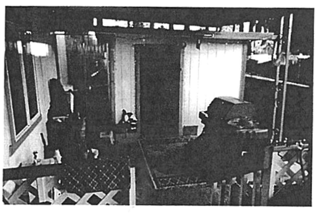 A police photograph shows the crime scene south of Everett where a woman was killed and another person shot last week. The shed, which was used as a living space, was the target of intruders leading up to the gunfire. (Snohomish County court records)