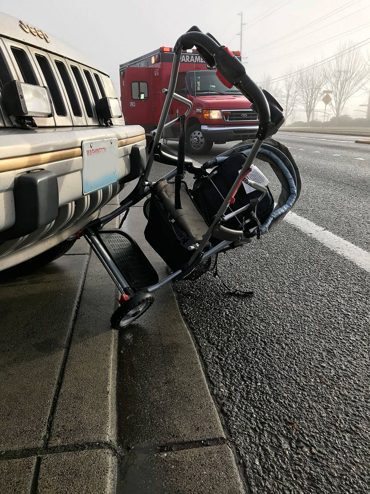 A Jeep struck Johanna Castillo and a stroller holding her 5-week-old son Dec. 4, north of Mill Creek. They weren't seriously hurt. (South Snohomish Fire and Rescue)