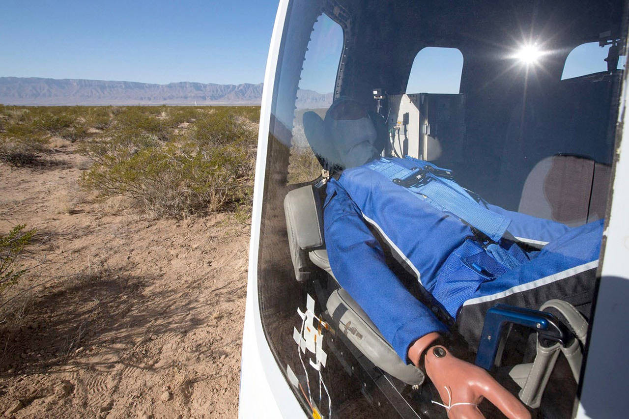 "A test flight dummy named ""Mannequin Skywalker"" sits in Blue Origin's crew capsule in West Texas after launching to the edge of space on Dec. 12. (Blue Origin)"