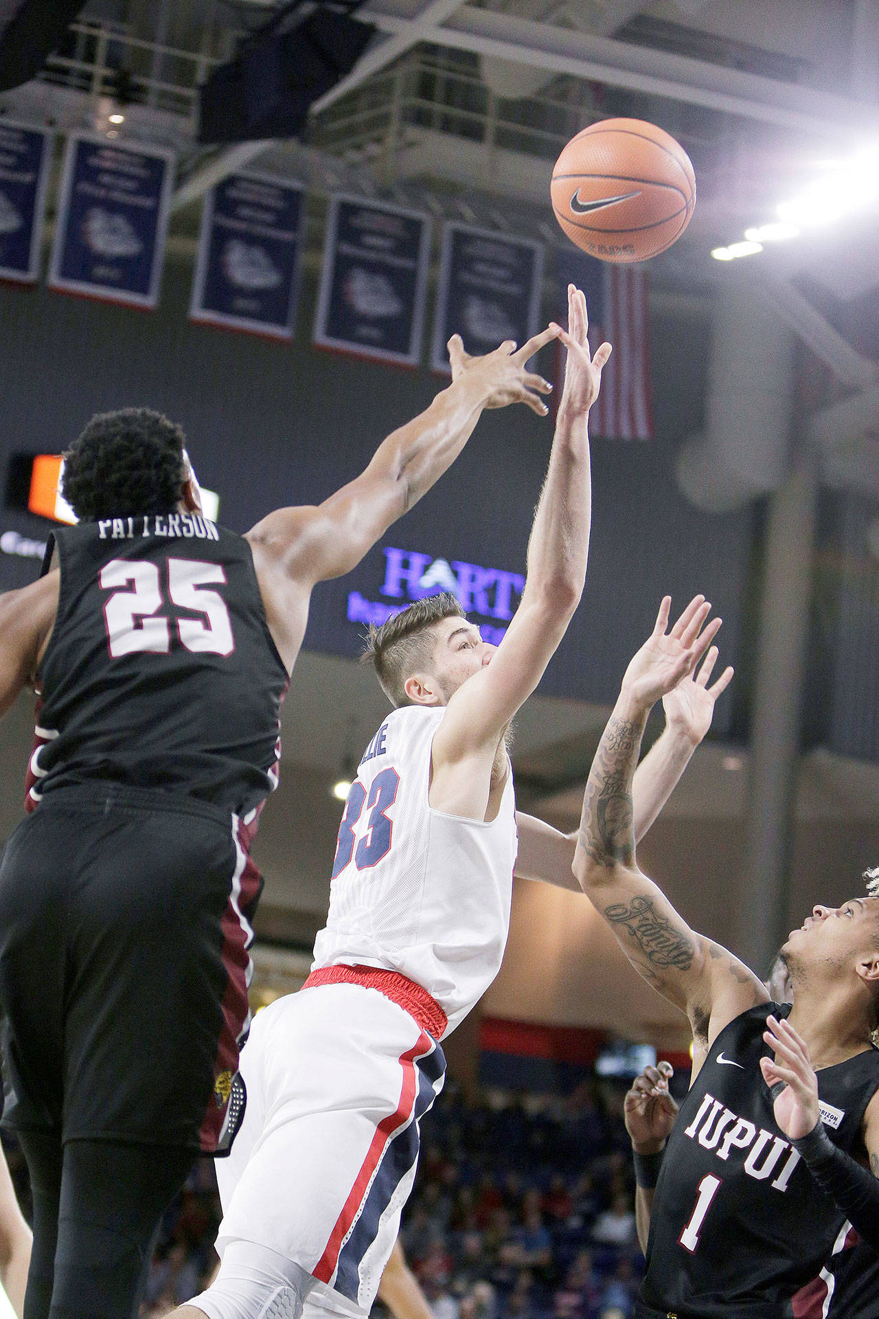 Gonzaga's Killian Tillie (33) shoots between IUPUI's Ron Patterson (25) and T.J. Henderson (1) during the first half of the No. 12 Bulldogs' 101-71 win Monday in Spokane. (AP Photo/Young Kwak)