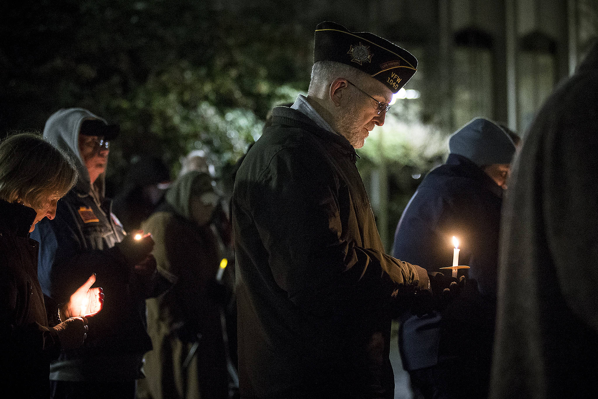 Army veteran Brian Seguin, of Everett, holds a candle at a vigil outside the Snohomish County Courthouse in Everett on Thursday in remembrance of deaths this year within the area's homeless population. The annual vigil had a special emphasis on homeless veterans and the difficulties they face. (Ian Terry / The Herald)