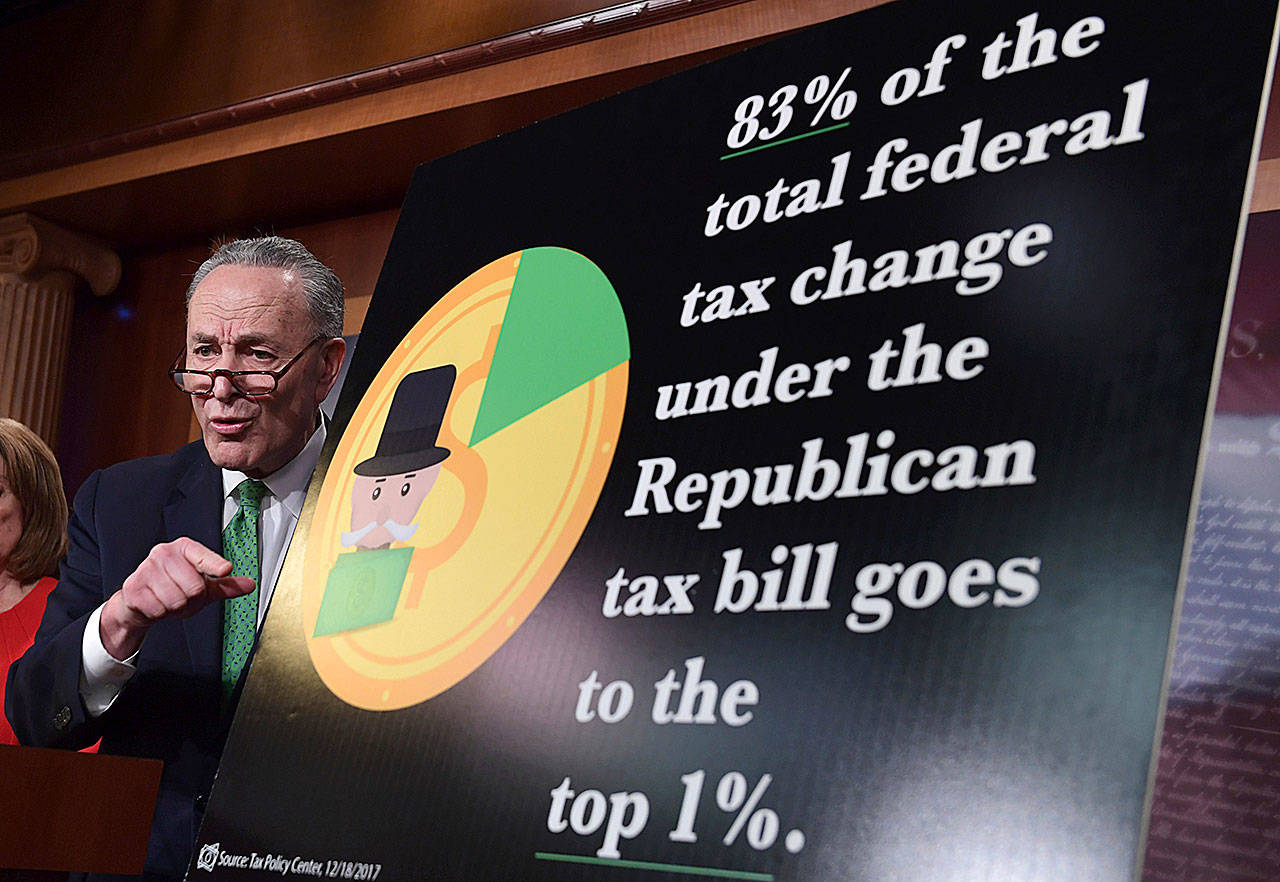 Senate Minority Leader Sen. Chuck Schumer, D-N.Y., speaks at a news conference on Capitol Hill on Wednesday. The massive $1.5 trillion tax package affects everyone's taxes but is dominated by breaks for business and higher earners. (AP Photo/Susan Walsh)