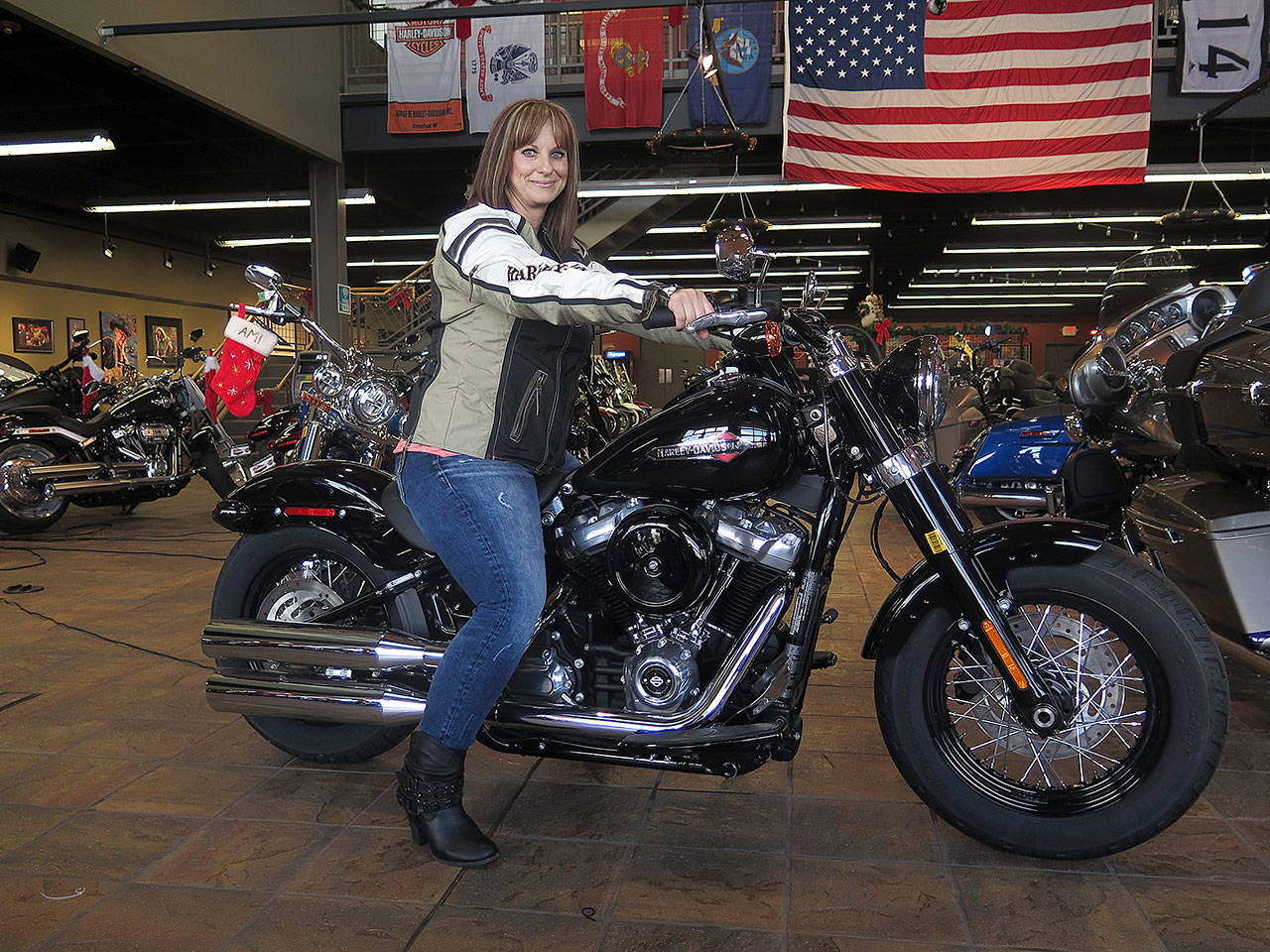 Terri Meehan sits on a 2018 Harley Softail Slim in Milwaukee's House of Harley on Dec. 12. Meehan took a riding course at the dealership. (AP Photo/Ivan Moreno)