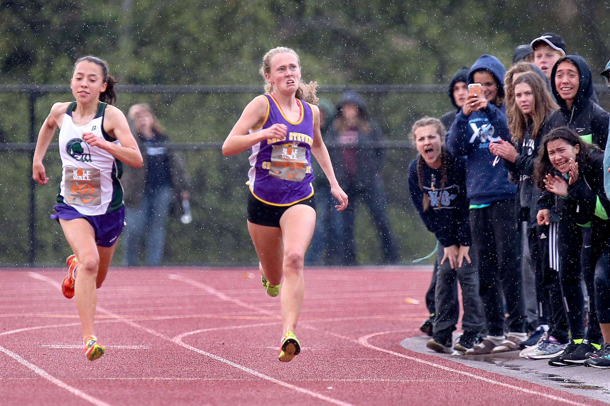 Edmonds-Woodway's Yukon Parle (left) edges out Lake Stevens' Taylor Roe for a first-place finish during the 34th annual Hole in the Wall Cross Country Invitational at Lakewood High School in Arlington on Oct. 7. (Kevin Clark / The Herald)