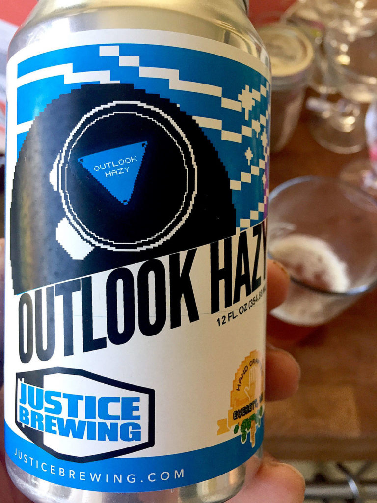 """Justice Brewing's """"Outlook Hazy"""" is a New England-style IPA that is juicy and slightly bitter in just the right combination. (Aaron Swaney)"""