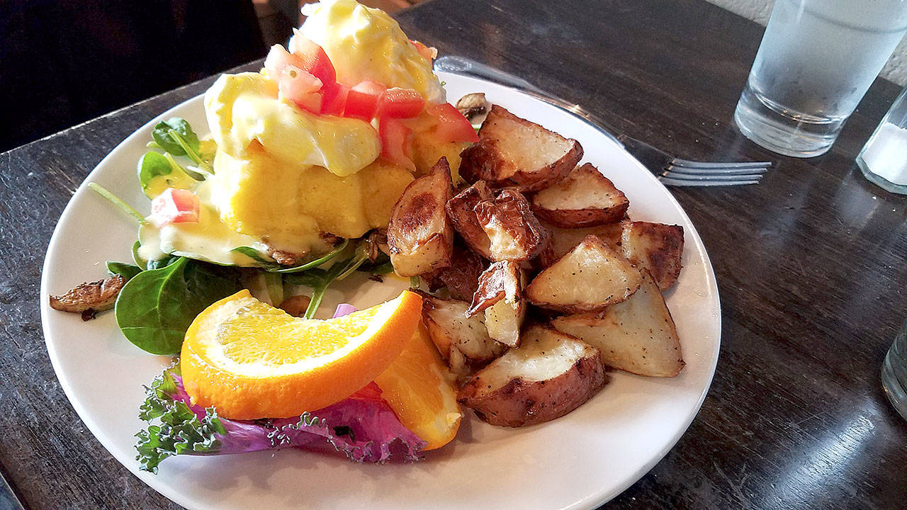 A plate of poached eggs with polenta cakes is $13 at the Red Twig Bakery & Cafe in Edmonds. (Sharon Salyer /The Herald)