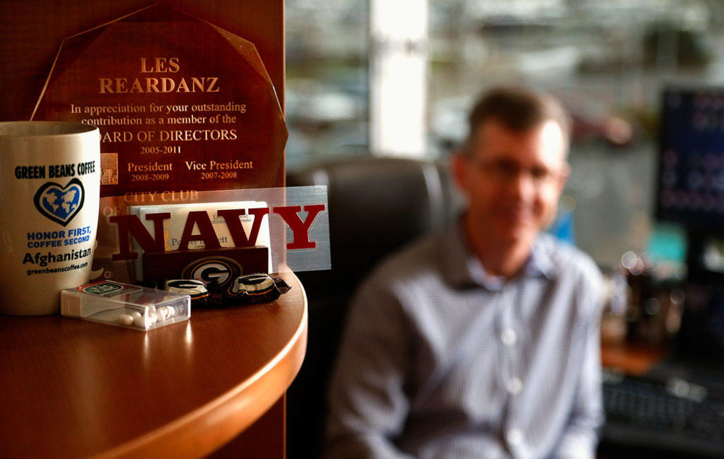 In corners and on shelves in Les Reardanz's office, the United States Navy maintains a presence. Now, the Port of Everett CEO and naval reservist will spend the better part of a year in Afghanistan. (Dan Bates / The Herald)