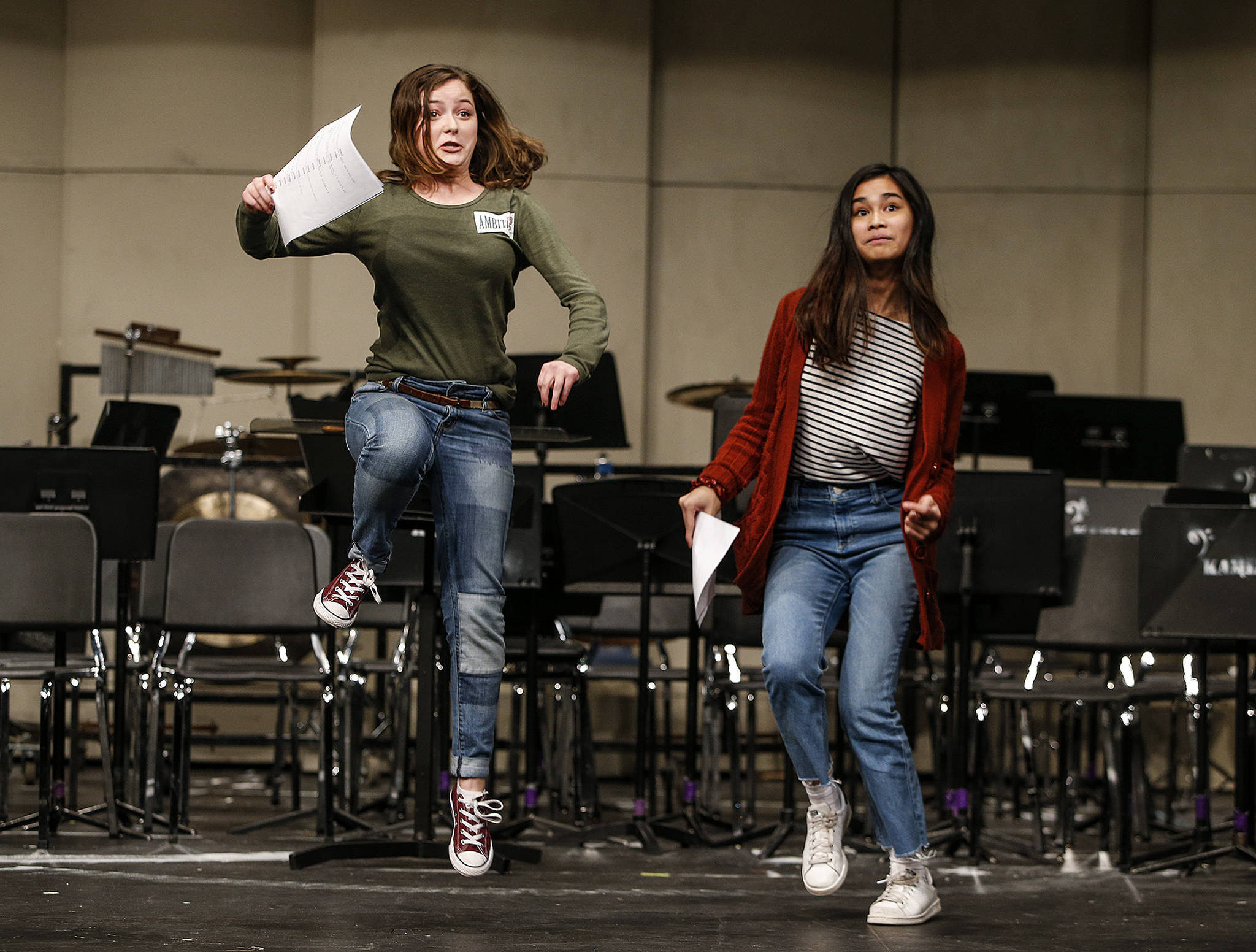 "Kamiak students Paige Cox (left) and Lauren Bocalan do their best to enunciate their lines while also pretending to ride a horse during an audition for ""Spamalot"" at the Mukilteo school. Both were cast. (Ian Terry / The Herald)"