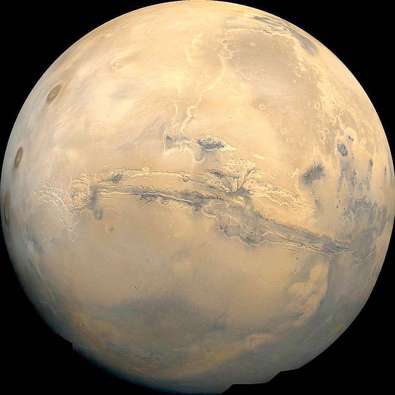 Planetary scientists say a new analysis of data shows that thick ice sheets hide just below parts of the surface of Mars. (NASA)