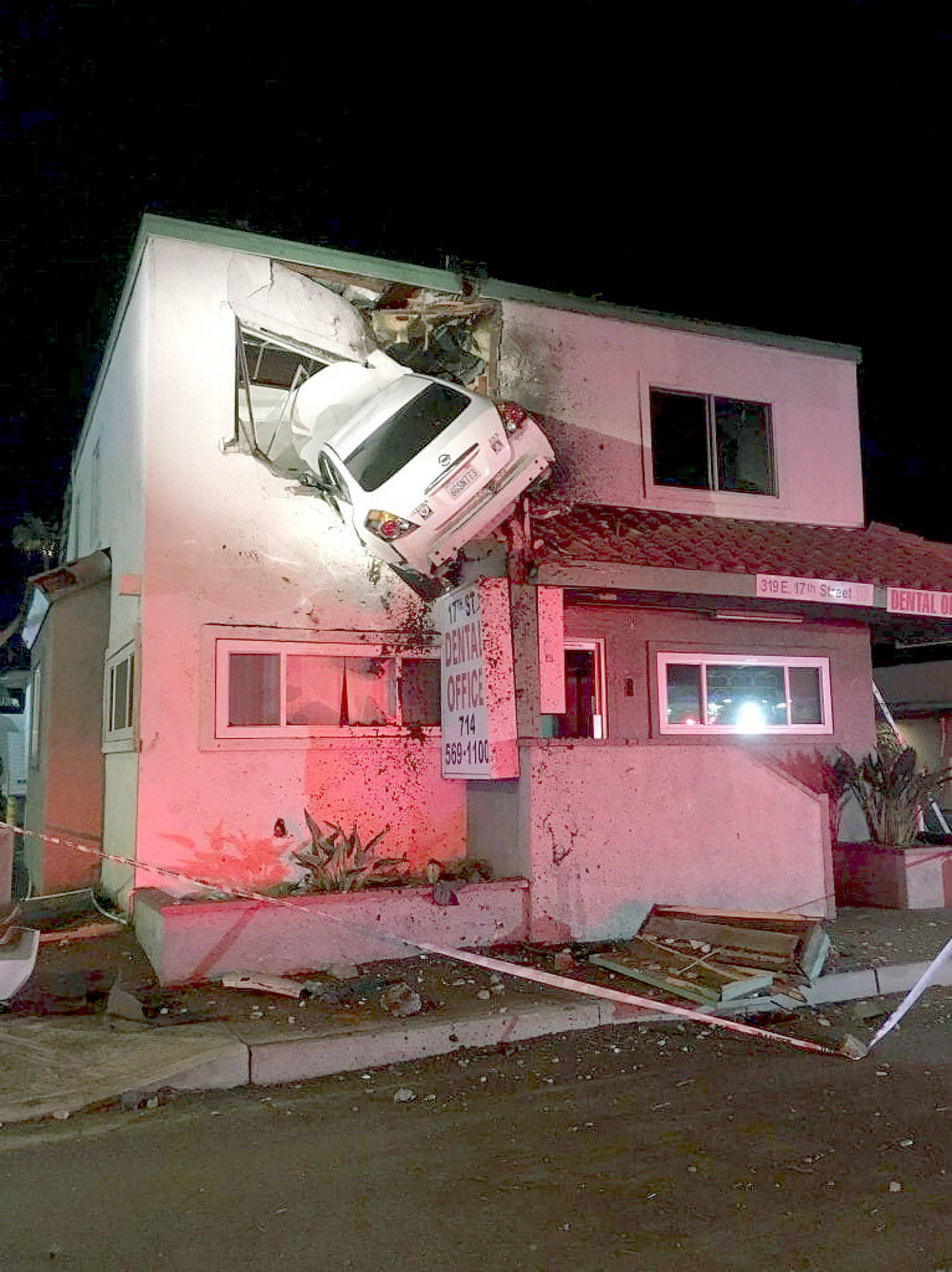 A Car Struck Center Divider Went Airborne And Crashed Into The Second Floor Of