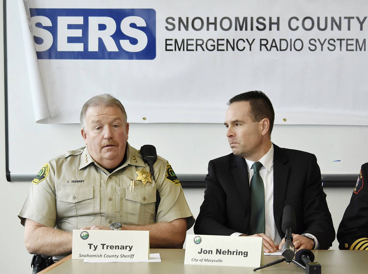 Snohomish County Sheriff Ty Trenary makes the case to upgrade an aging radio system for police and firefighters at a press conference Thursday. Jon Nehring, mayor of Marysville and board president of the Snohomish County Emergency Radio System, announced a $70 million plan for digital radios and radio towers in Snohoimsh County. (Caleb Hutton / The Herald)
