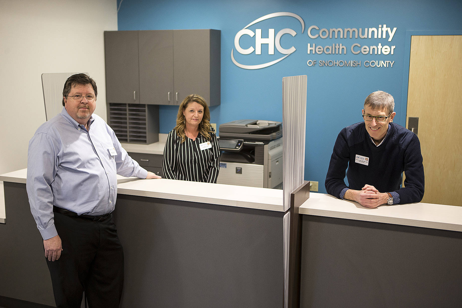 Health Center of Snohomish County Chief Executive Officer Bob Farrell (from left), Chief Operating Officer Lisa Miller and Chief Clinical Officer Dr. Thomas Tocher stand in the newest clinic location on Rucker Avenue in Everett.Ian Terry / The Herald Community
