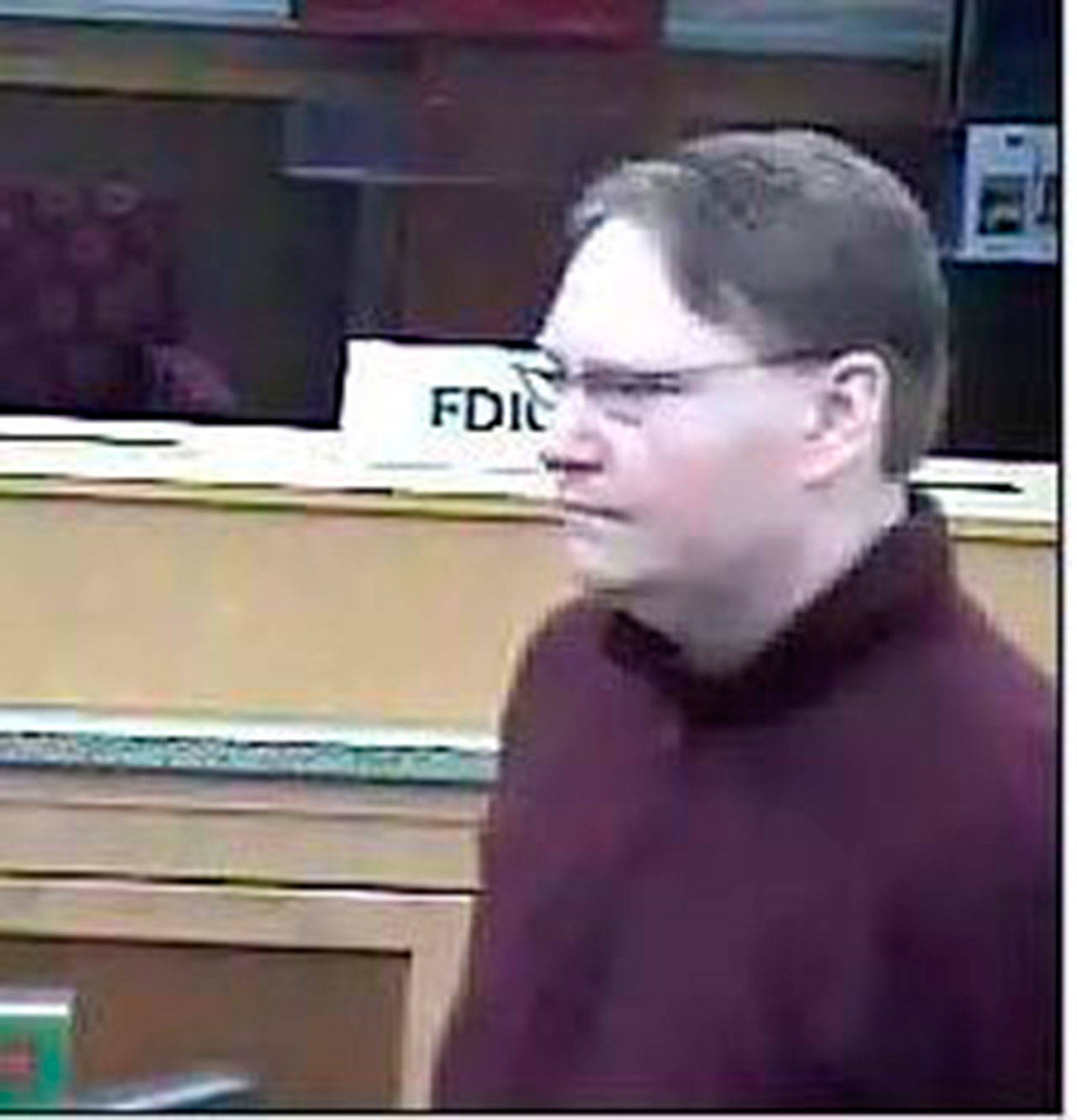 Security photos show a man who robbed a Wells Fargo on Thursday in Lynnwood. Police believe he struck a U.S. Bank on Monday, too. (Lynnwood Police Department)