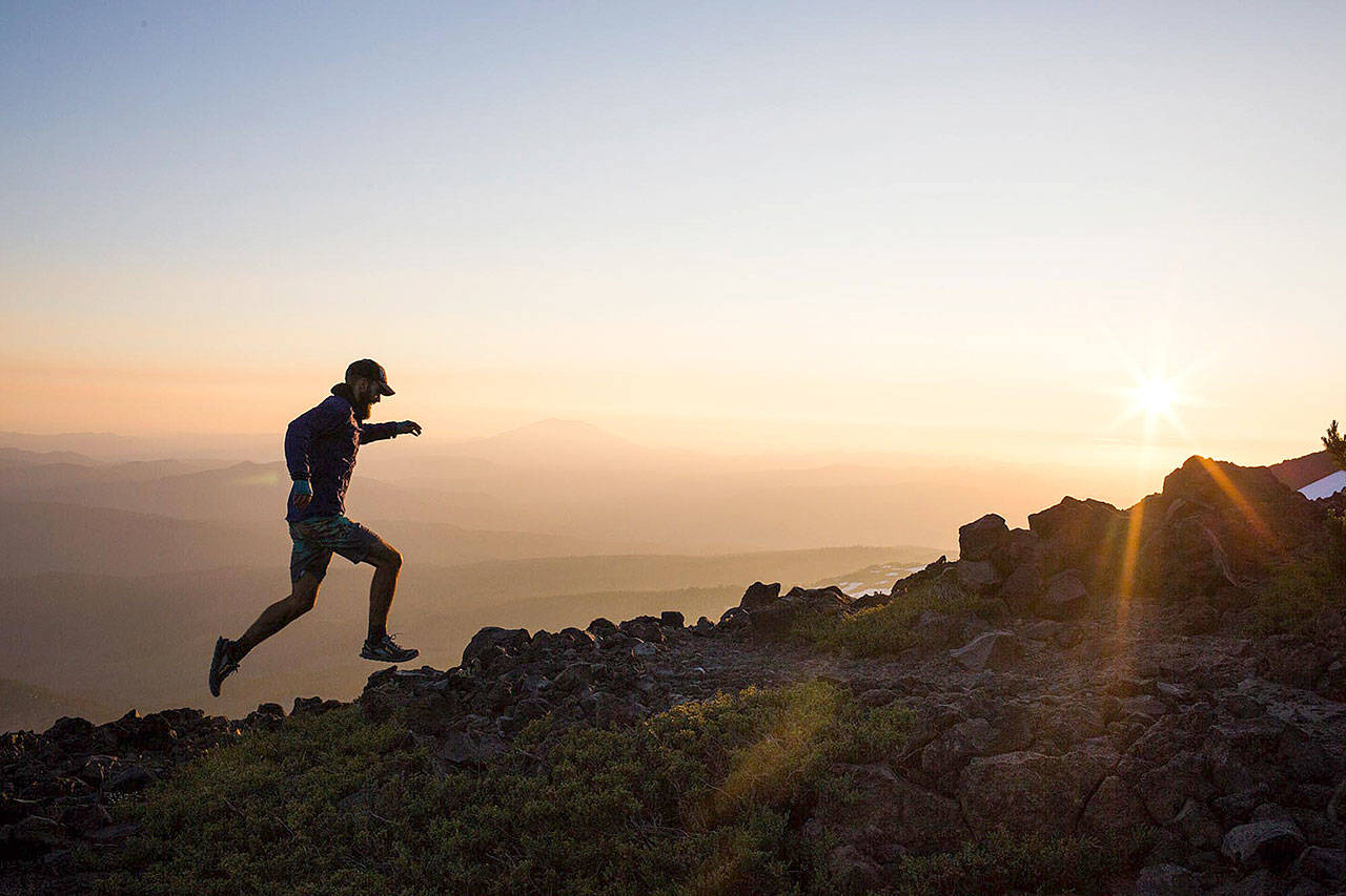 Hikers in Action, first place: This photo of a man running along the rocks at Mount Adams by Sofia Jaramillo won top honors in the Hikers in Action category.