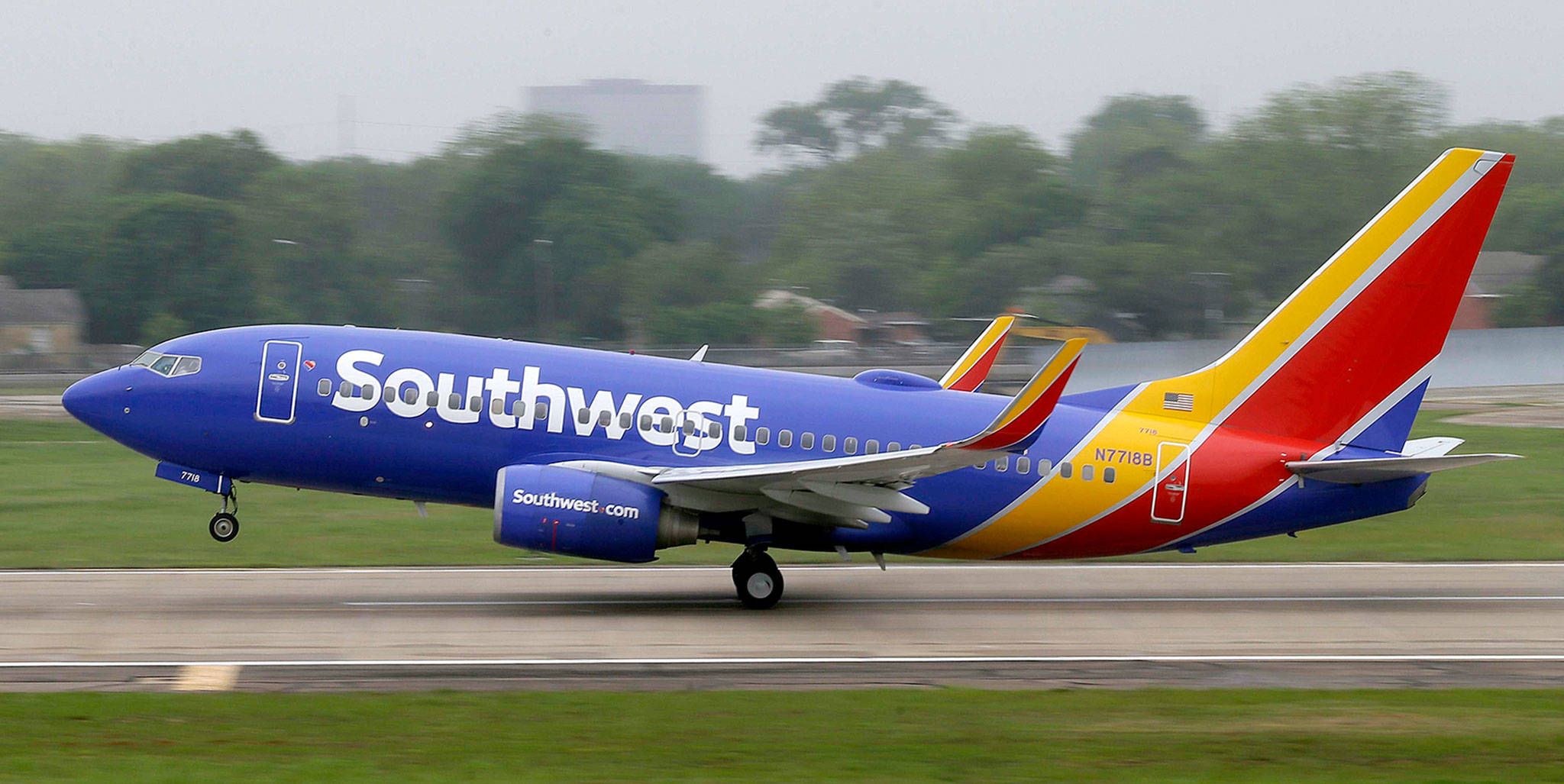 A Southwest Airlines Boeing 737 takes off from a runway at Love Field in Dallas. (AP Photo/LM Otero, File)
