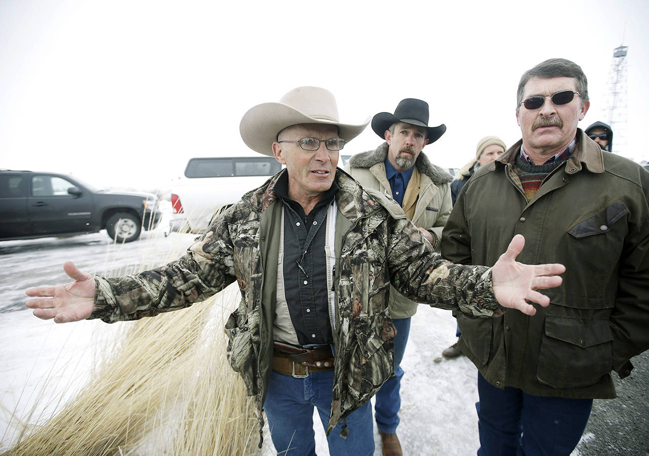 "In this Jan. 9, 2016 photo, Robert ""LaVoy"" Finicum (left) a rancher from Arizona, talks to reporters at the Malheur National Wildlife Refuge near Burns, Oregon. (AP Photo/Rick Bowmer, File)"