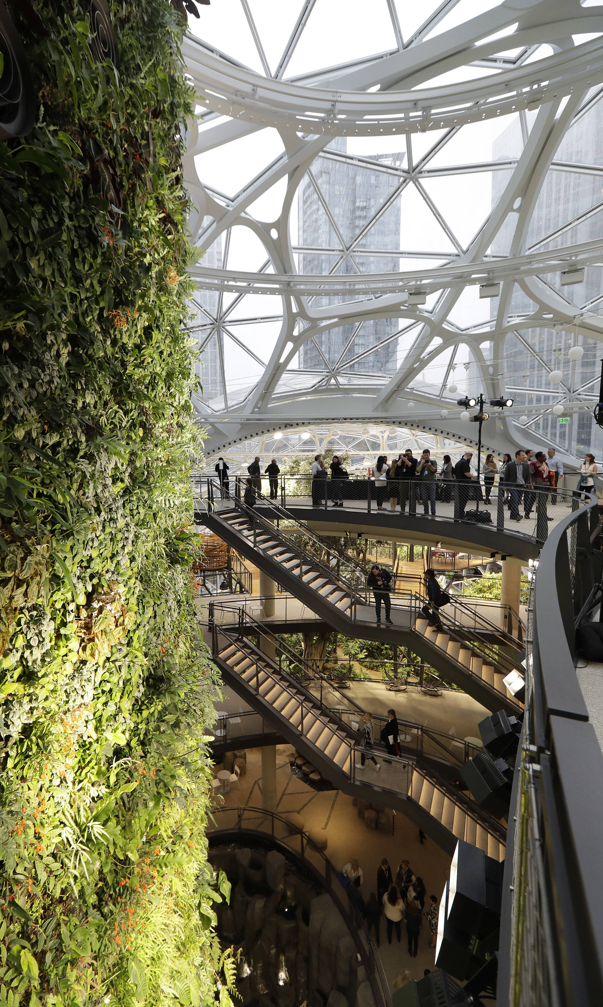Gathering spaces and a plant-filled wall are shown before a grand opening ceremony for the Amazon Spheres on Monday in Seattle. (AP Photo/Ted S. Warren)