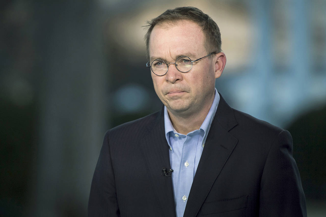 Director of the Office of Management and Budget Mick Mulvaney stands for a television interview at the White House in Washington on Jan. 20. (Jabin Botsford/Washington Post)