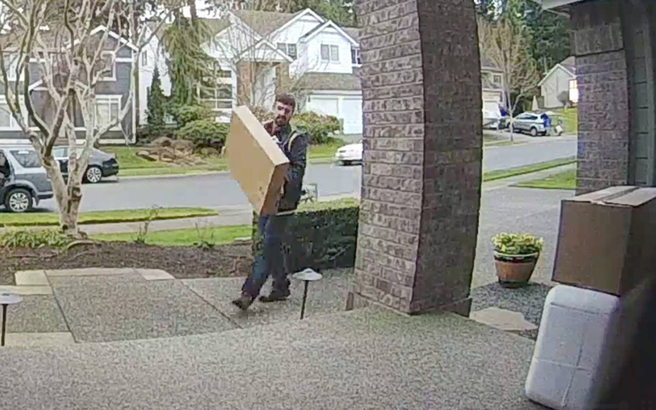 Mill Creek police seek the public's help in identifying a man who stole two packages from the front porch of a Mill Creek residence. (City of Mill Creek)