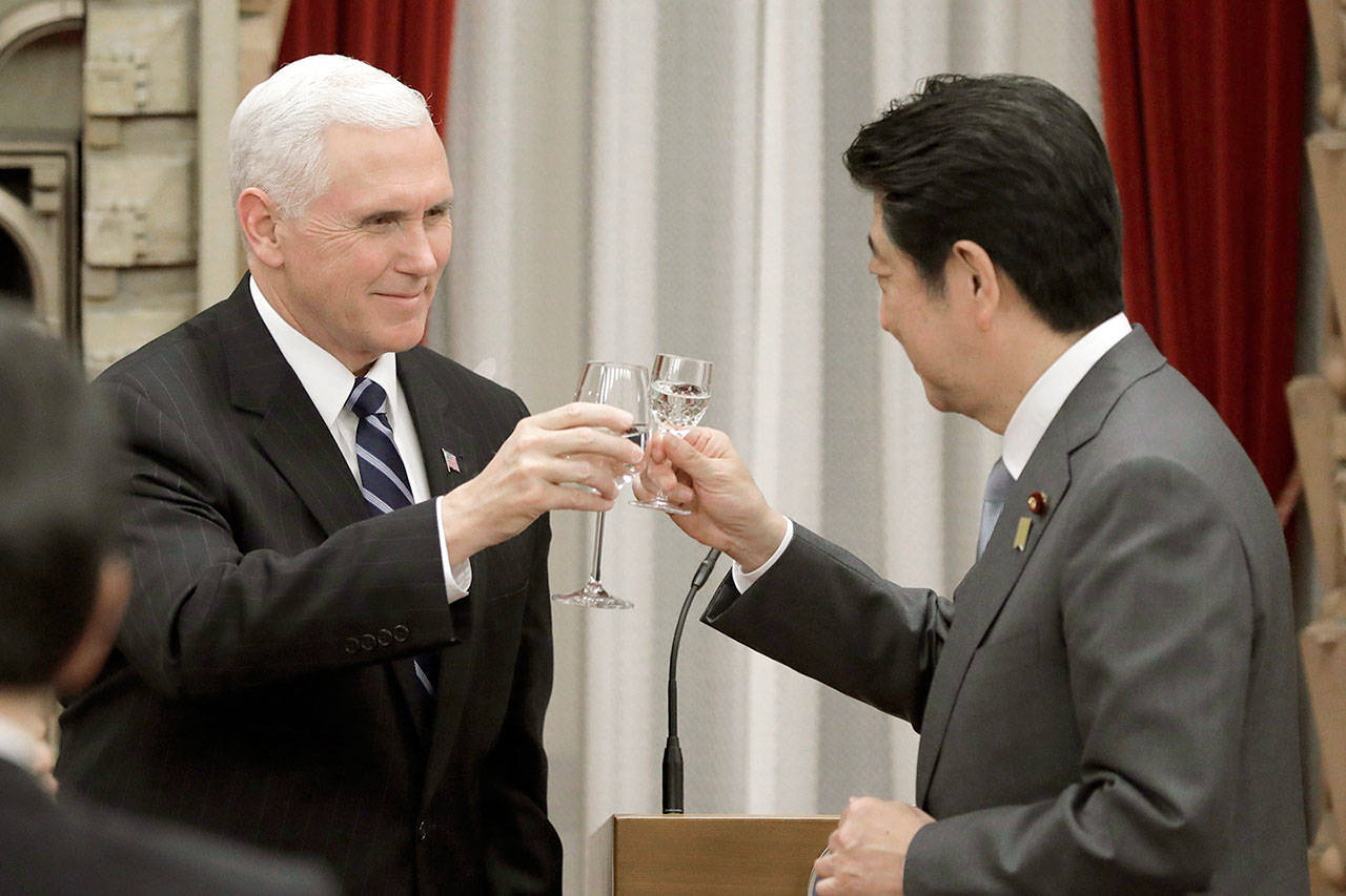 U.S. Vice President Mike Pence makes a toast with Japan's Prime Minister Shinzo Abe during a banquet hosted by Abe at the prime minister's official residence in Tokyo on Wednesday. (Kiyoshi Ota/Pool Photo via AP)