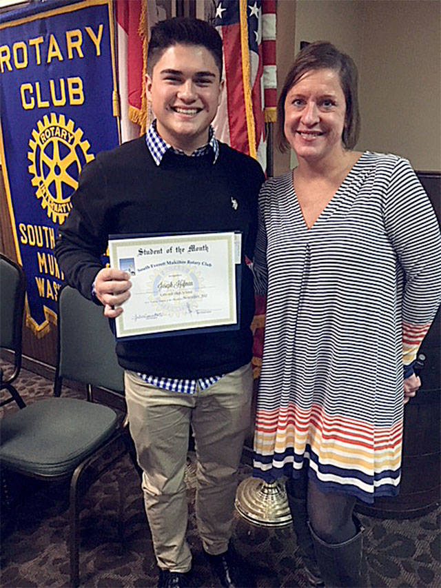 South Everett-Mukilteo Rotary Club President Julie Frauenholtz (right) congratulates Cascade High School's Joe Hofman on being named a Student of the Month. (Contributed photo)
