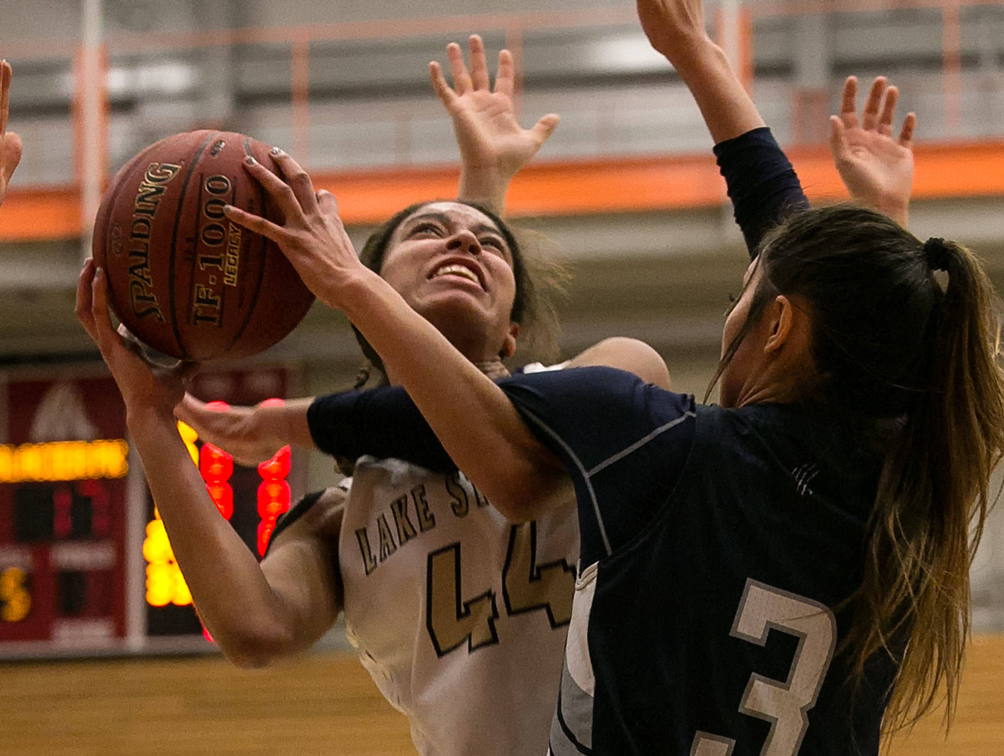 Lake Stevens' Kylee Griffen (left) attempts a shot with Glacier Peak's Makayla Guerra defending during the 4A district championship on Feb. 15, 2018, at Everett Community College. (Kevin Clark / The Herald)