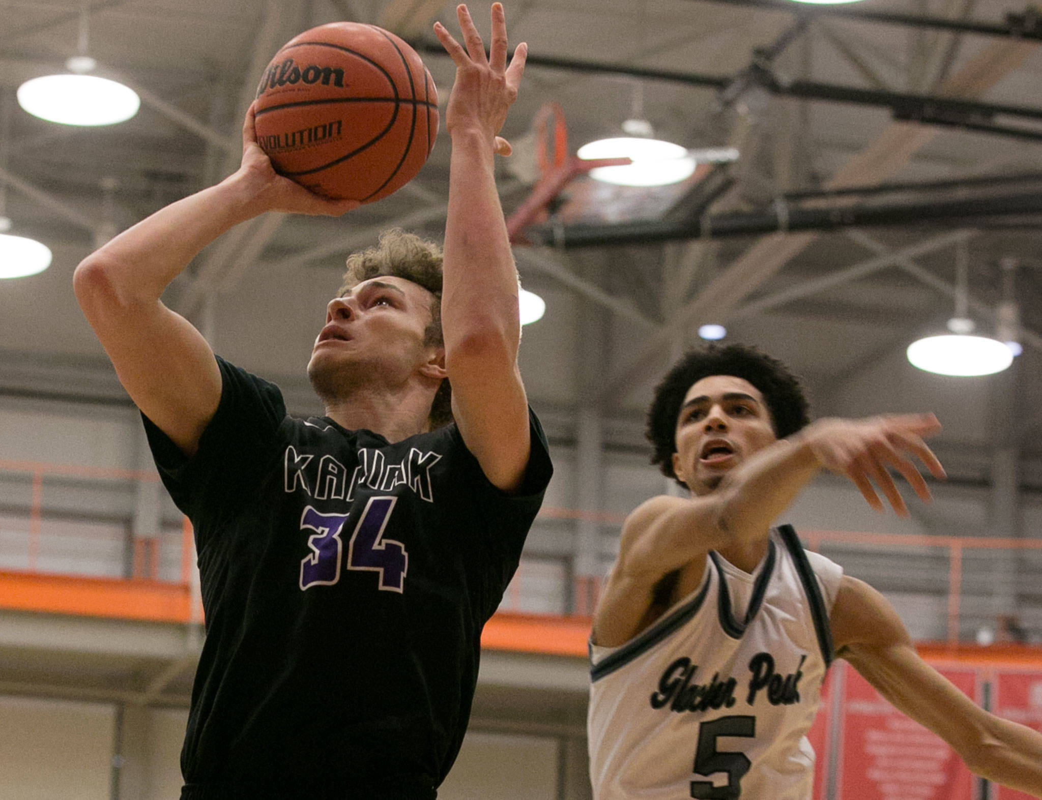Kamiak's Daniel Sharpe attempts a shot as Glacier Peak's Trey Lawrence defends during the 4A district championship game on Feb. 15, 2018, at Everett Community College. (Kevin Clark / The Herald)