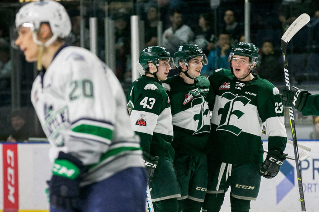 The Everett Silvertips celebrate the second goal of the first period against the Seattle Thunderbirds at the Showare Center Friday night in Kent February 16, 2018. (Kevin Clark / The Daily Herald)