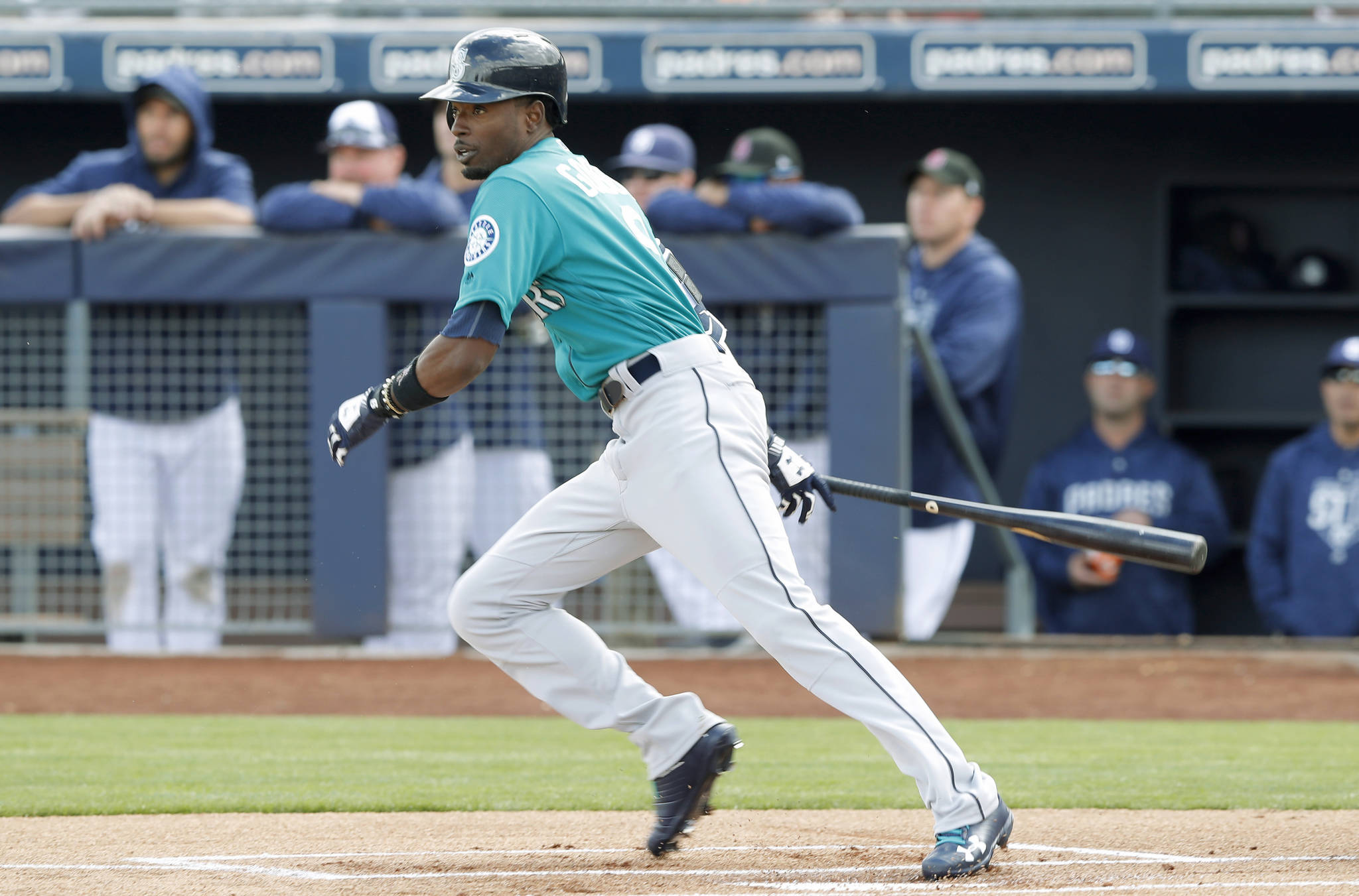 Charlie Neibergall / Associated Press                                 Seattle's Dee Gordon hits a double during the first inning of Friday's game in Peoria, Ariz.