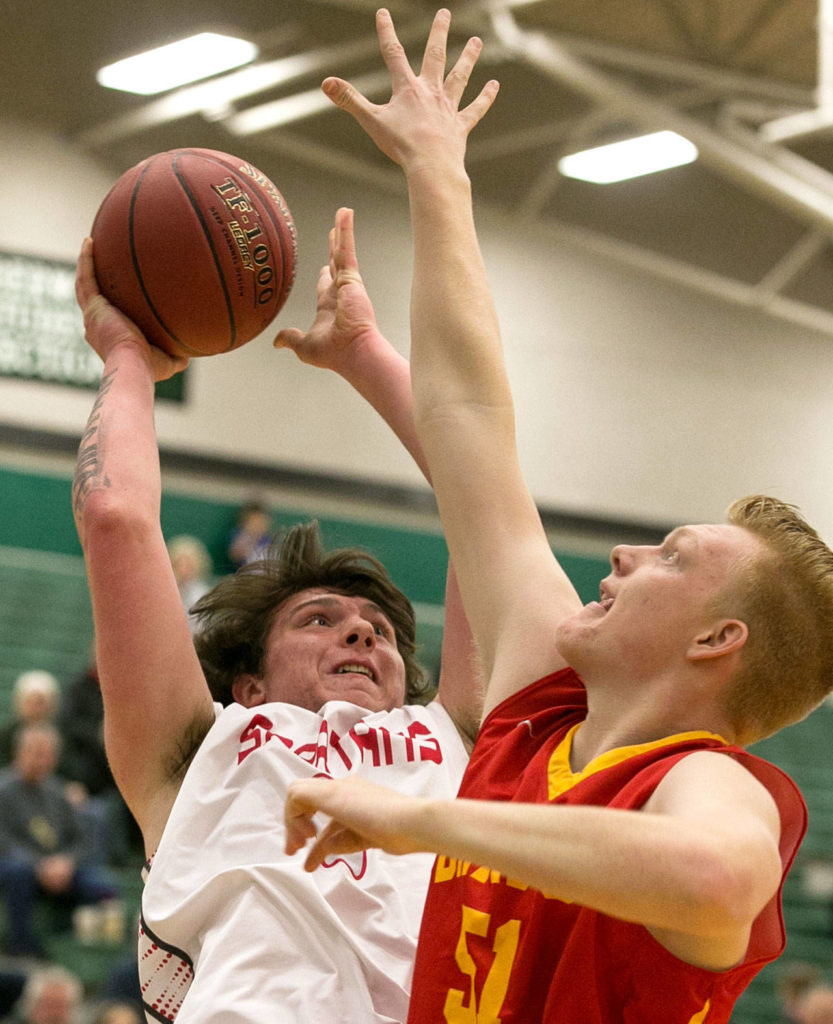 Stanwood's Mitch Jones attempts a shot over Kamiakin's Kyson Rose during a regional playoff game Saturday afternoon at Jackson High School in Mill Creek. (Kevin Clark / The Herald)