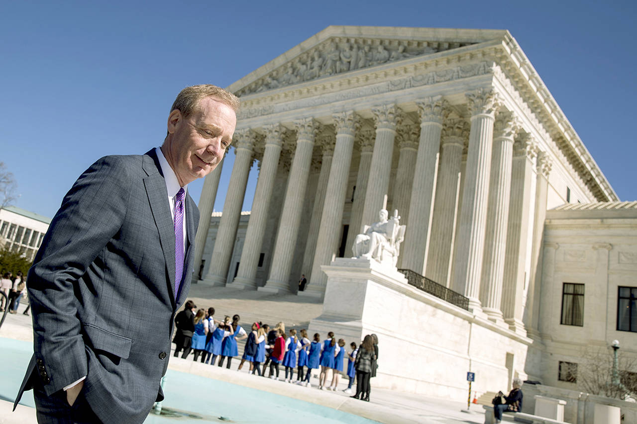 Microsoft President and Chief Legal Officer Brad Smith leaves the Supreme Court on Tuesday in Washington. (AP Photo/Andrew Harnik)