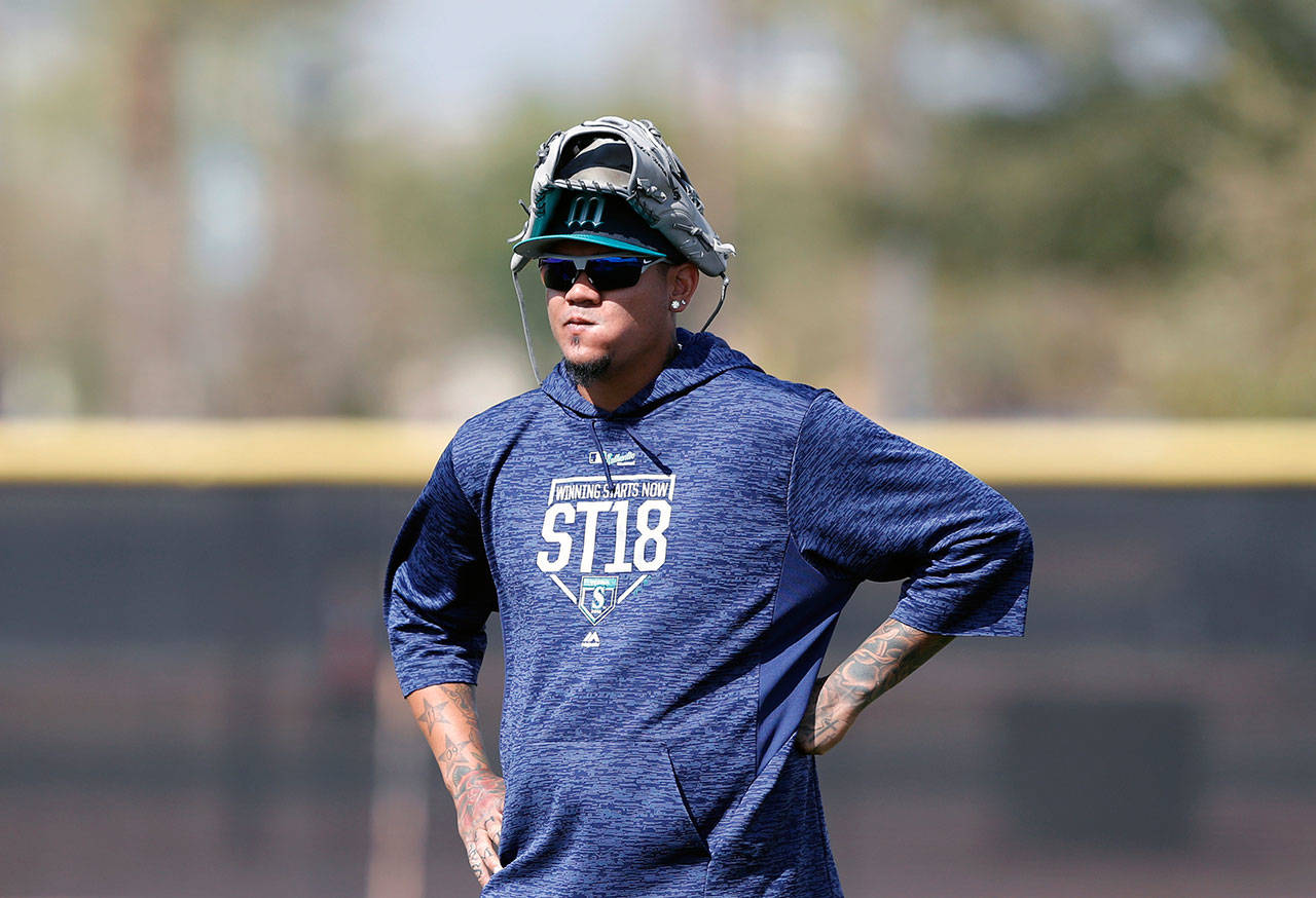 Mariners starting pitcher Felix Hernandez watches a drill during a spring training workout on Feb. 19, 2018, in Peoria, Ariz. (AP Photo/Charlie Neibergall)