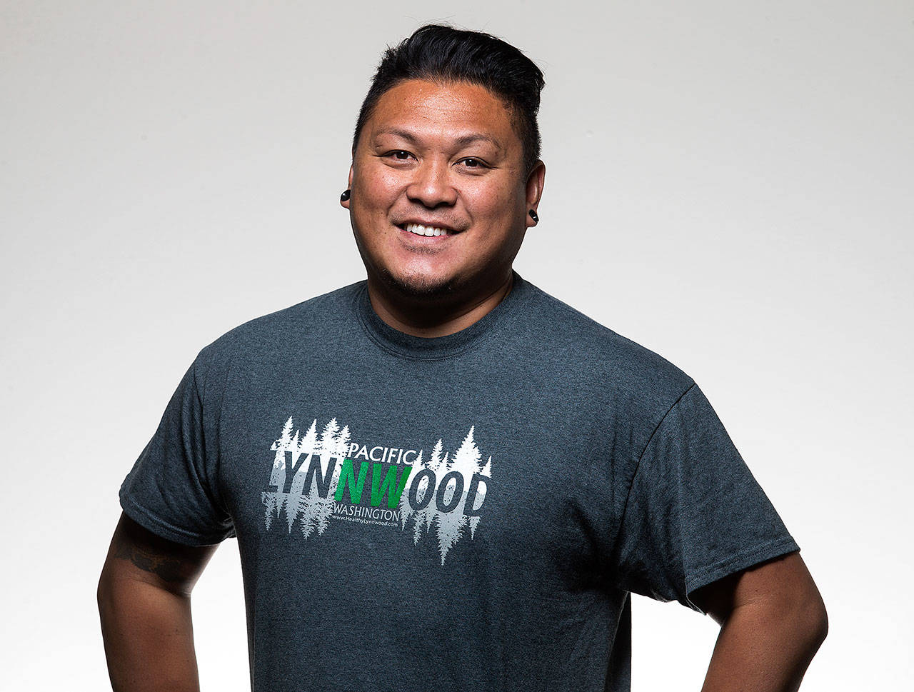 Allan C. Carandang designed the winning Lynnwood T-shirt in a 2017 contest to celebrate what people love about Lynnwood. (Andy Bronson / The Herald)