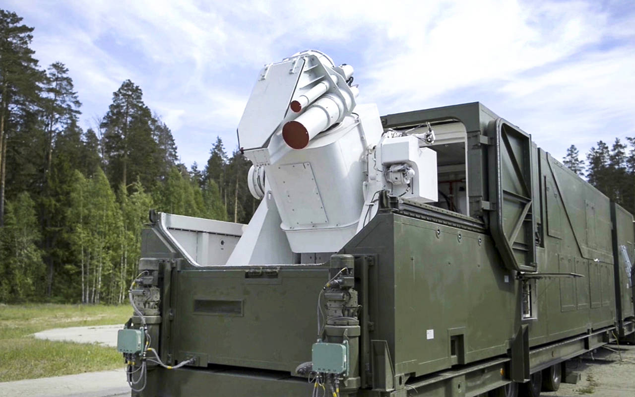 In this March 1 video grab, a Russian military truck with a laser weapon mounted on it is shown at an undisclosed location in Russia. (RU-RTR Russian Television via AP)